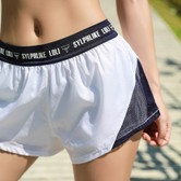 暴走的萝莉 字母跑步健身短裤女夏季 内衬防走光薄款透气训练三分裤/白撞海军蓝#/M